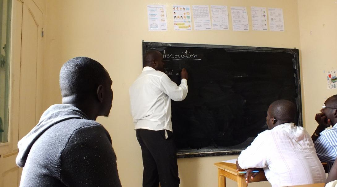 A teaching volunteer write on the board during a lesson in Senegal.
